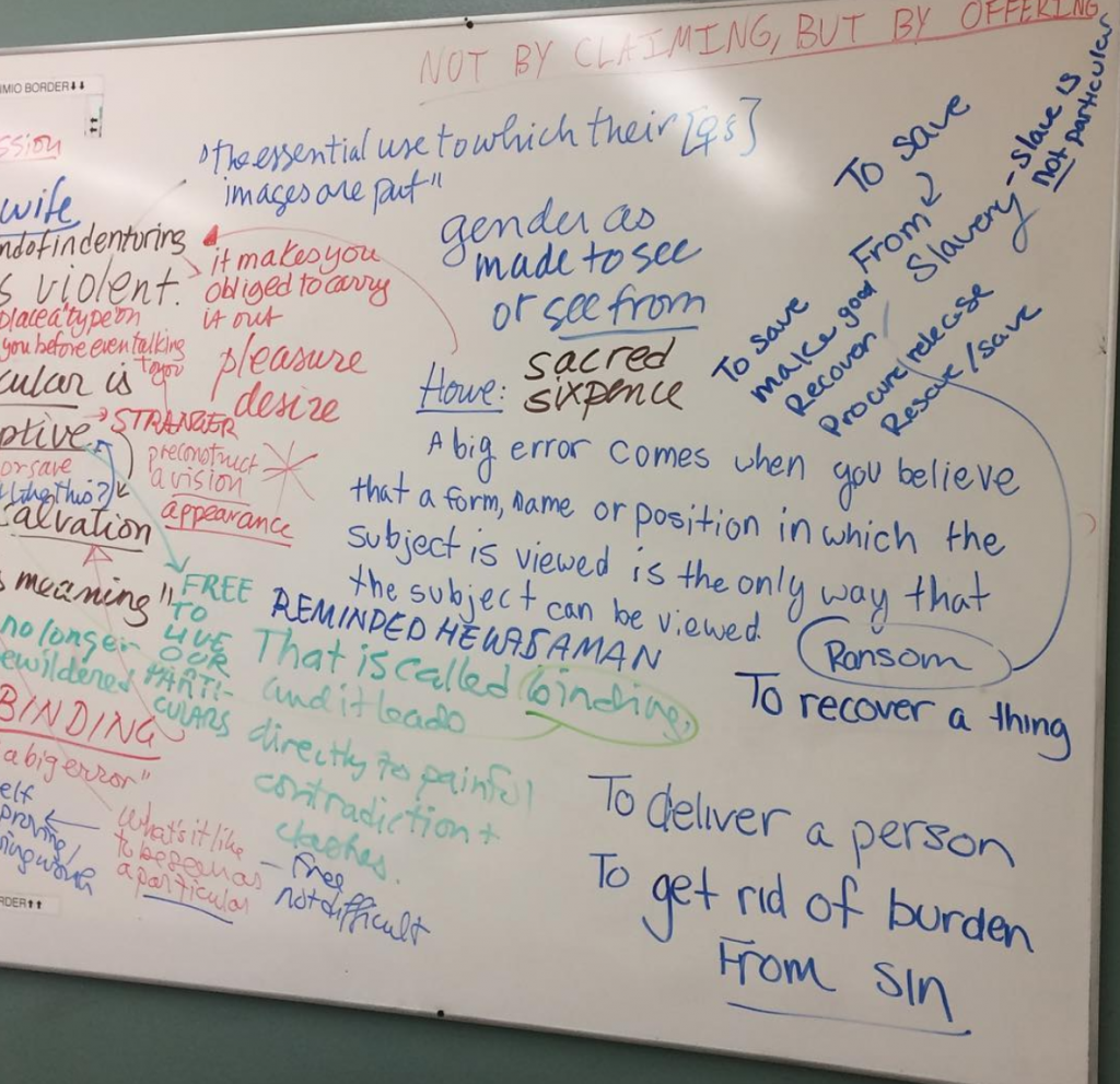 Image of a whiteboard with many people's handwriting on it